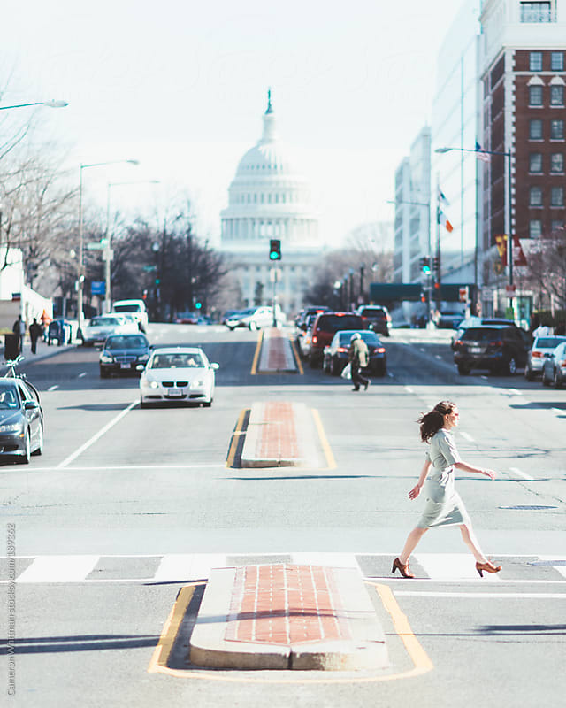 Commuter crossing North Capitol street in Washington DC  by Cameron Whitman for Stocksy United