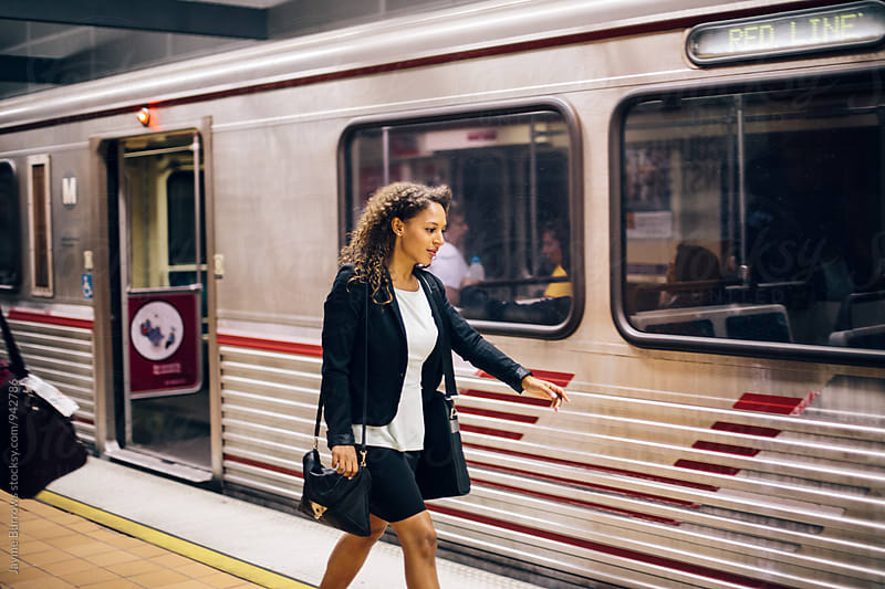 Young Professional Woman Rushes to Get on the Metro by Jayme Burrows for Stocksy United