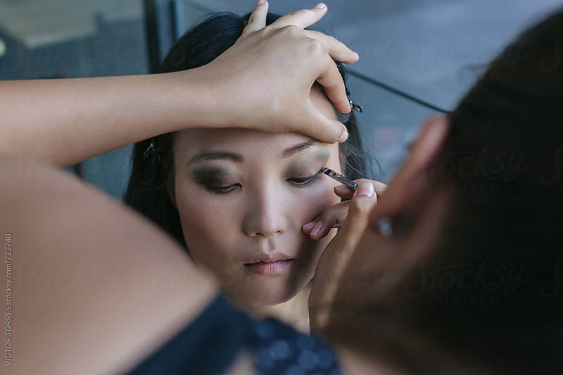 Make-up Artist Working with a Japanese Model in the Street by VICTOR TORRES for Stocksy United