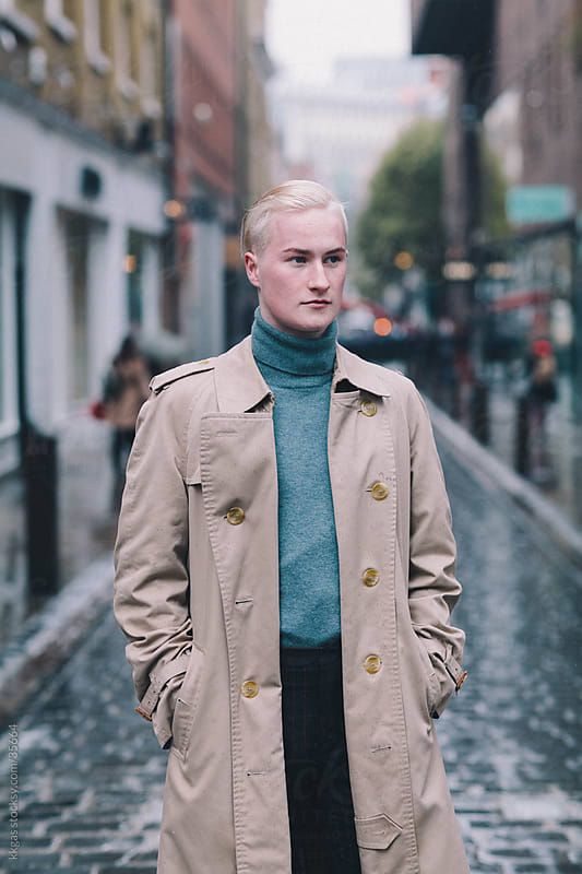 Fashionable man wearing trenchcoat in London by kkgas for Stocksy United