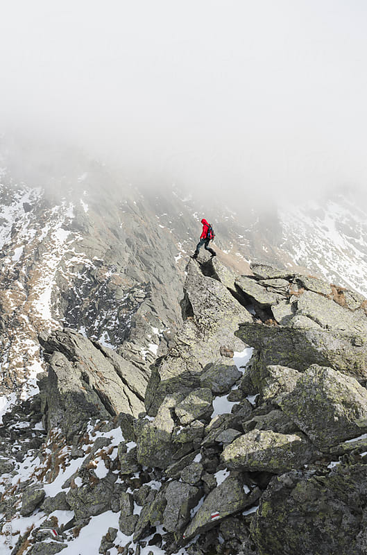 Mountaineer on a rocky mountain peak by RG&B Images for Stocksy United