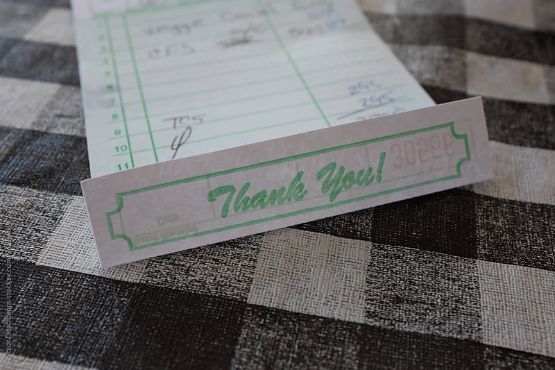 Thank You Note On Check by Victor Deschamps for Stocksy United