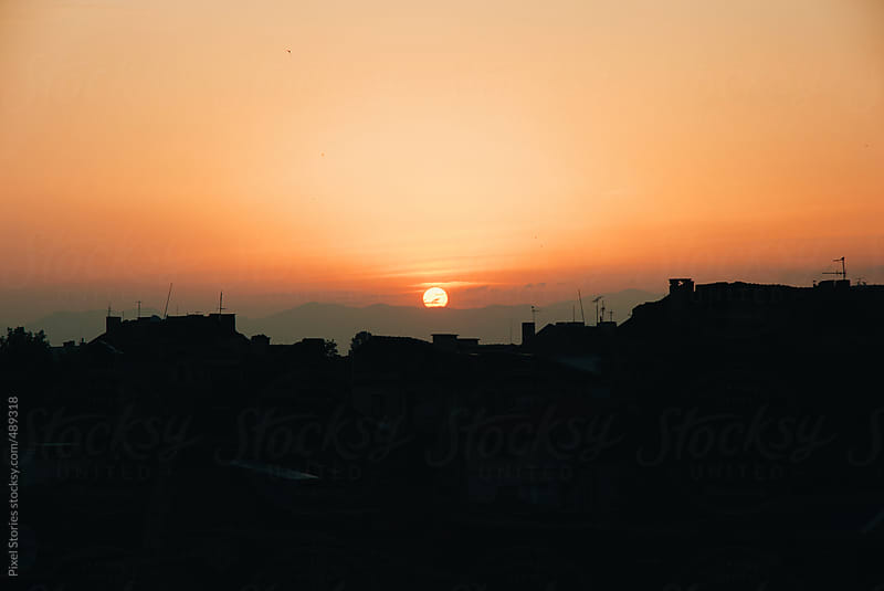 Sunrise over city by Pixel Stories for Stocksy United