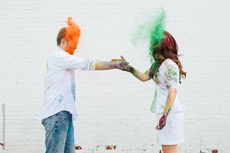 couple exchanging some Holi color by Brian Powell for Stocksy United