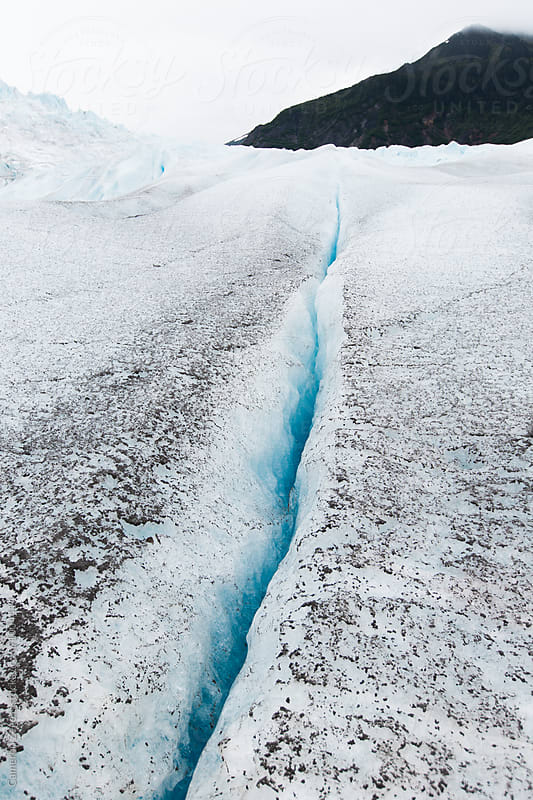 glacial crevasse by Cameron Zegers for Stocksy United