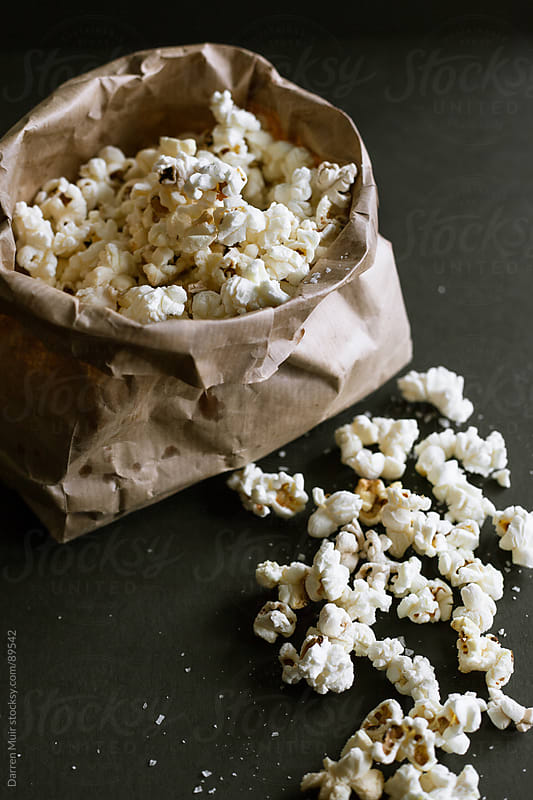 Popcorn in a bag. by Darren Muir for Stocksy United