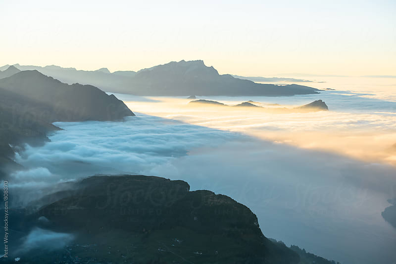 Sunset view over sea of fog by Peter Wey for Stocksy United