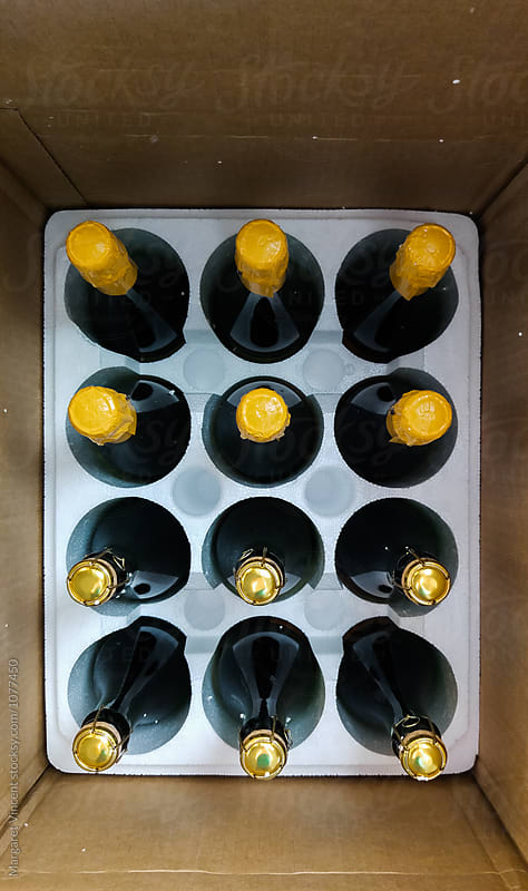 a case of sparkling wine by Margaret Vincent for Stocksy United
