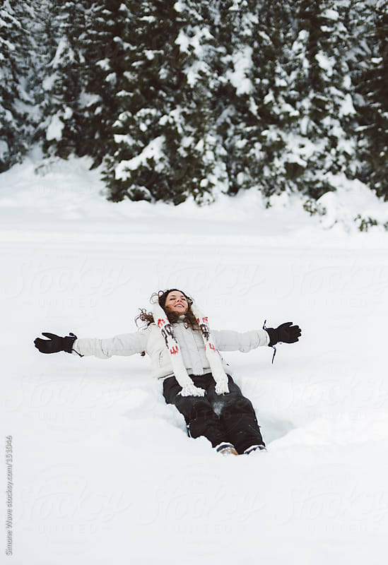 Woman jumping into snow by GIC for Stocksy United