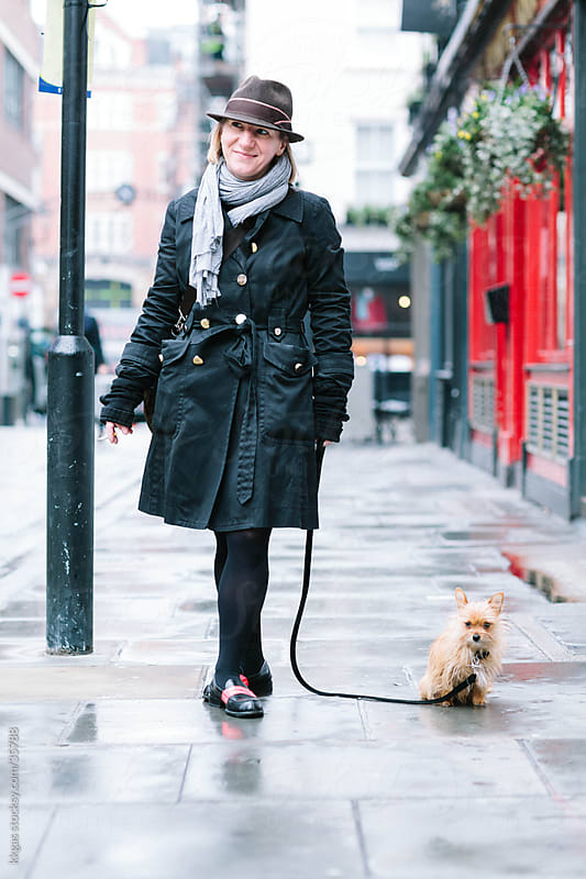 Elegant woman with chihuahua in Soho London. by kkgas for Stocksy United