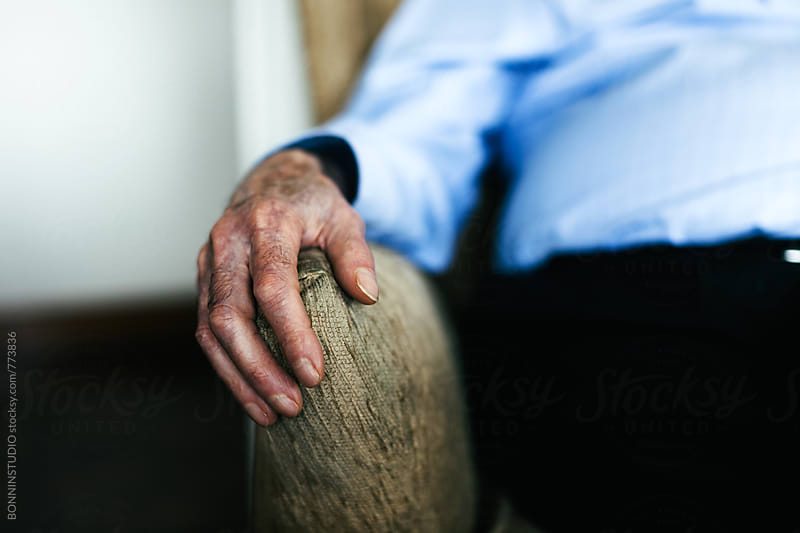 Hands of an elderly man sitting at home. Grandfather. by BONNINSTUDIO for Stocksy United