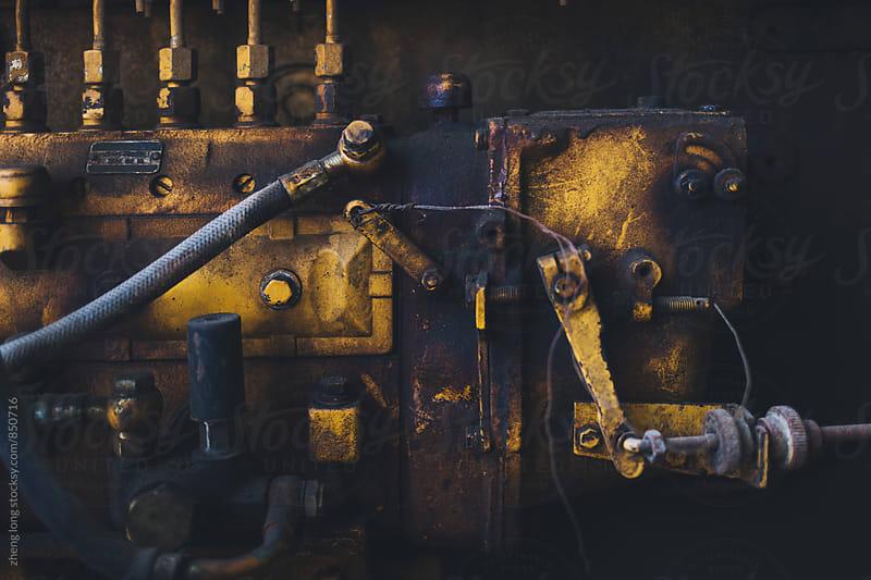 Diesel engine in vehicle repair plant by zheng long for Stocksy United