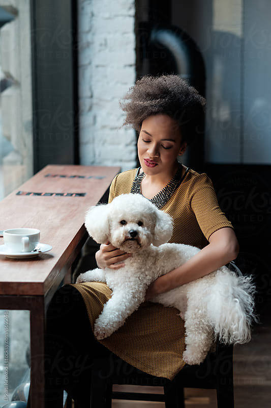 Woman Sitting at the Cafe with her Dog by Brkati Krokodil for Stocksy United