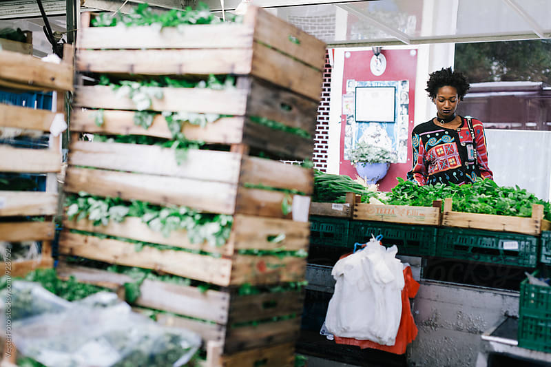 Black Woman Shopping at Outdoor Market by VegterFoto for Stocksy United