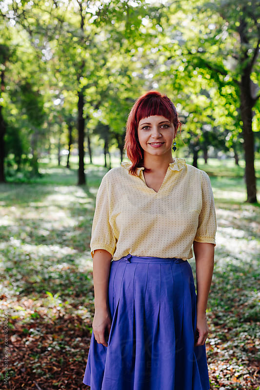 Redhead Woman in the Park by Mosuno for Stocksy United
