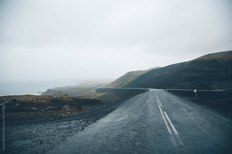 Windy Deserted Road Along The Coast Of Iceland by Laura Austin for Stocksy United
