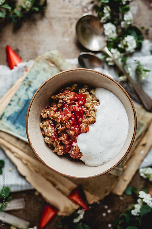 Vegan strawberry crumble with coconut cream by Tatjana Ristanic for Stocksy United