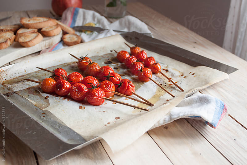Roasted tomatoes crostini by Nataša Mandić for Stocksy United