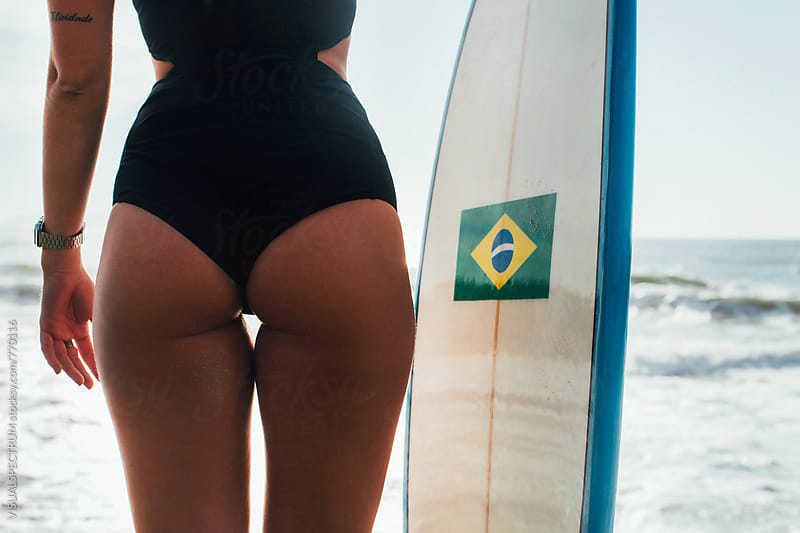 Bum of Hot Female Surfer Girl Posing With Surfboard on Ipanema Beach in Rio de Janeiro by VISUALSPECTRUM for Stocksy United