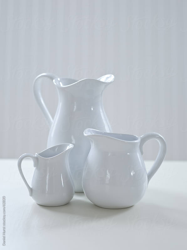 Three white porcelain pitchers by Daniel Hurst for Stocksy United