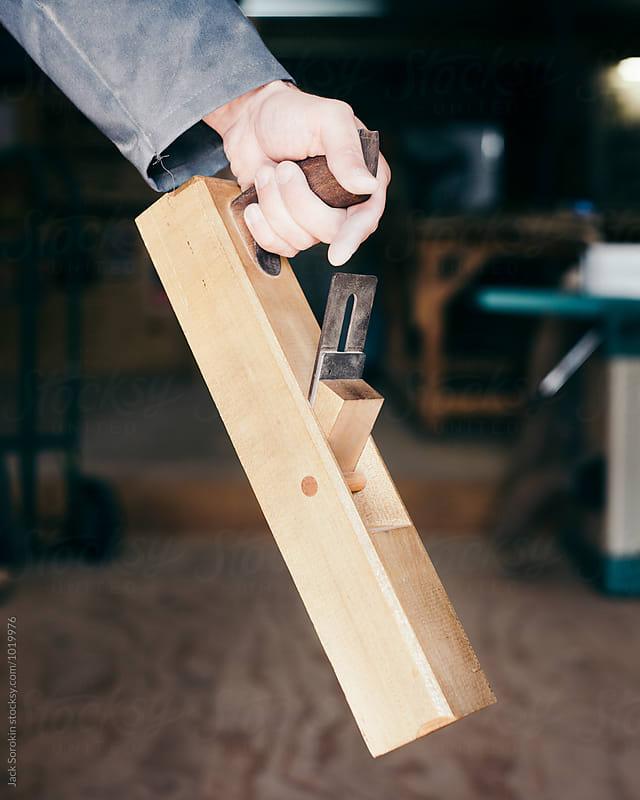 Wood craftsman holding hand wood planer by Jack Sorokin for Stocksy United