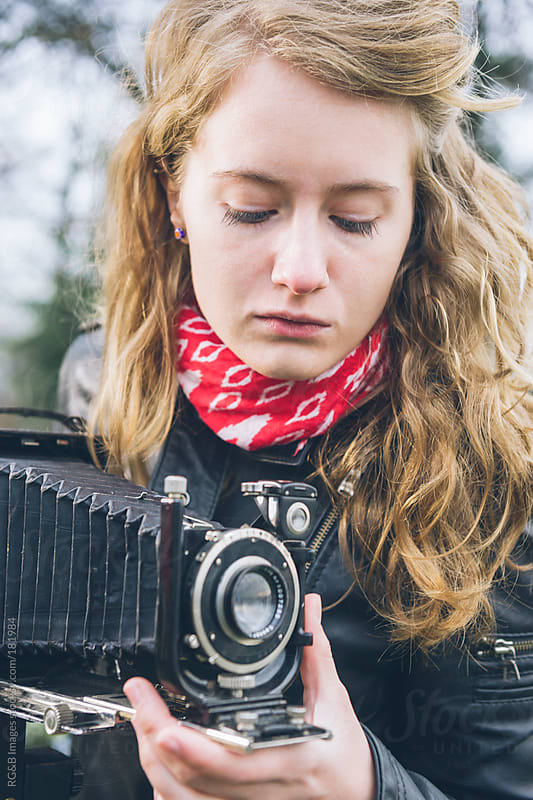 Photographer with vintage folding camera  by RG&B Images for Stocksy United