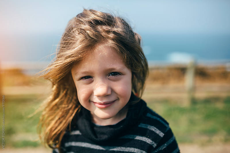 Portrait of a Cute Little Girl Outdoors by VICTOR TORRES for Stocksy United