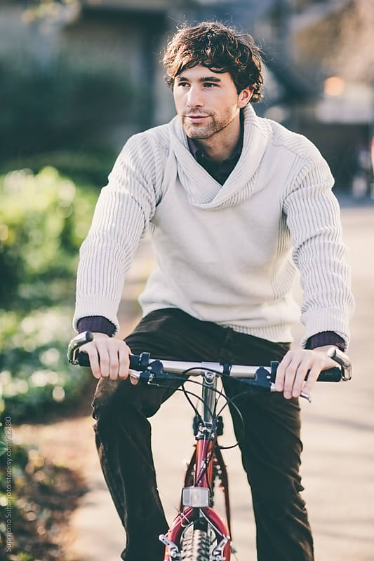 Stylish young man riding a bicycle by Suprijono Suharjoto for Stocksy United