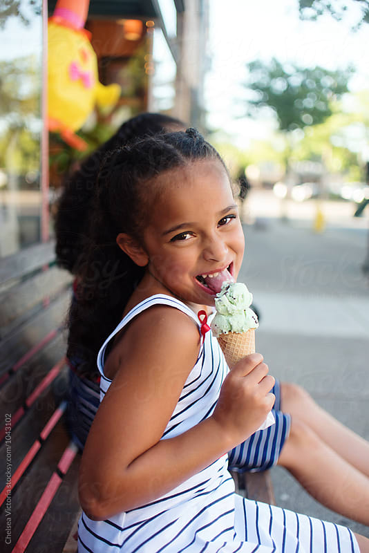 Young sisters eating ice cream by Chelsea Victoria for Stocksy United