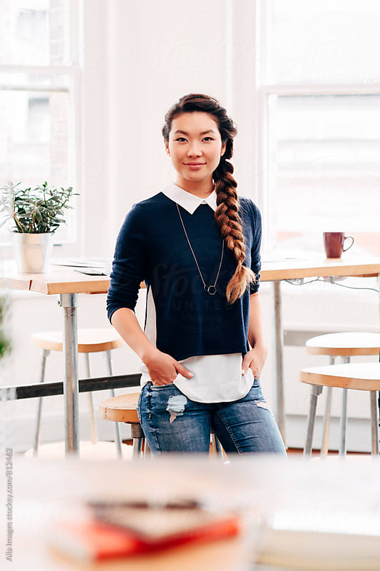 Portrait of Asian businesswoman entrepreneur at work in stylish startup by Aila Images for Stocksy United
