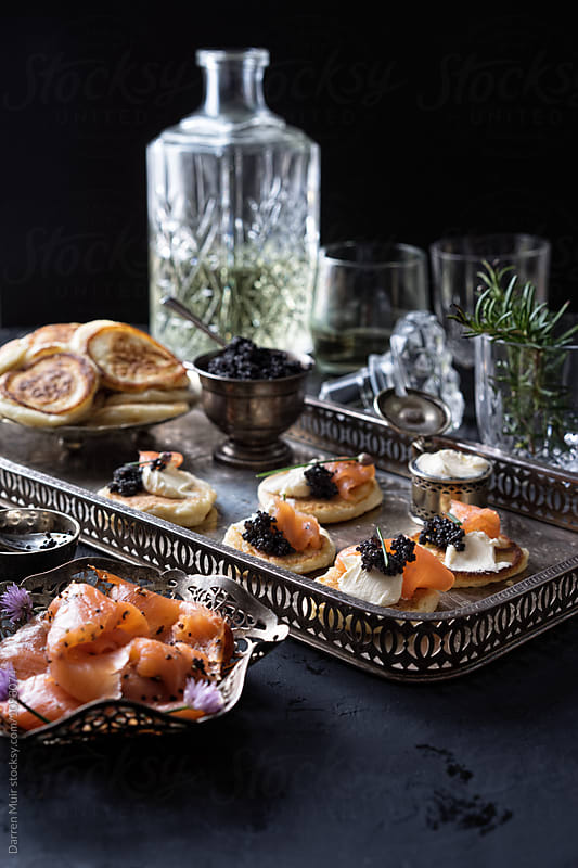 Blinis with smoked salmon,cream cheese and caviar. by Darren Muir for Stocksy United