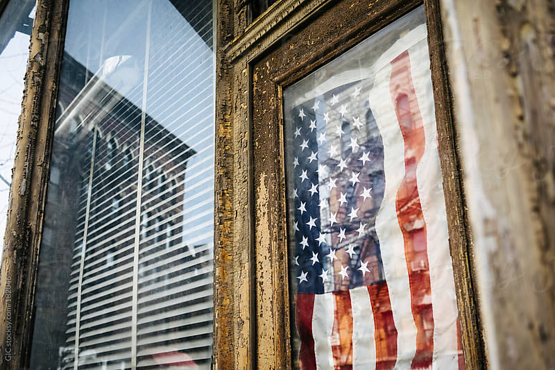 USA flag on the door of a vintage hipster shop in Williamsburg, Brooklyn by GIC for Stocksy United