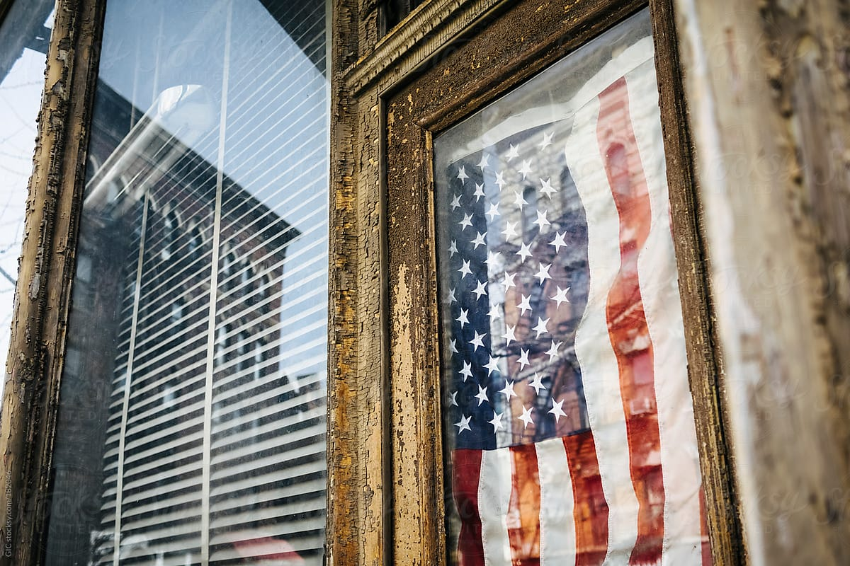 USA flag on the door of a vintage hipster shop in
