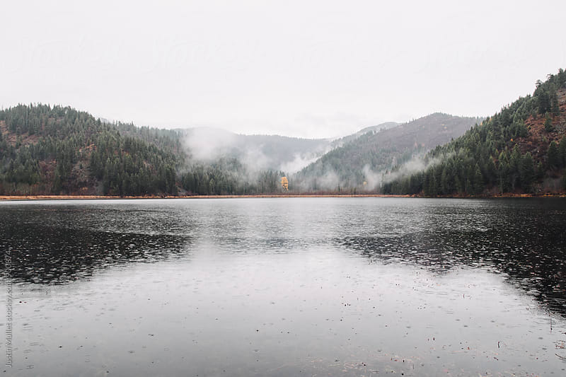 Small mountain lake in Idaho on a rainy morning by Justin Mullet for Stocksy United
