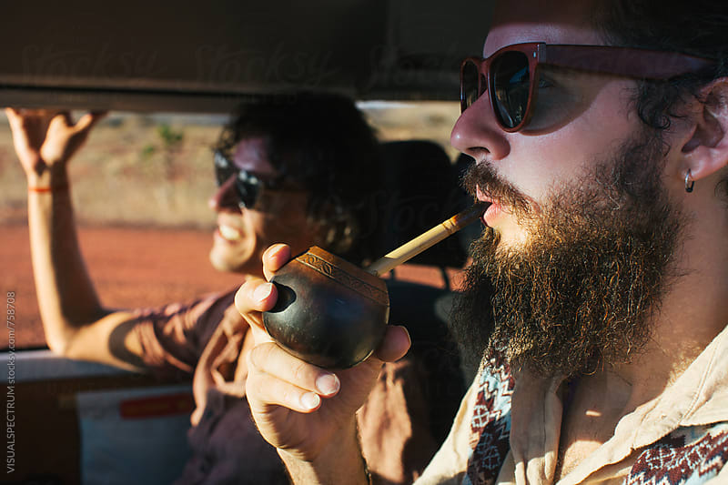 Hippie Road Tripping - Profile of Bearded Male Hippie Drinking Mate While Driving Camper Van by Julien L. Balmer for Stocksy United
