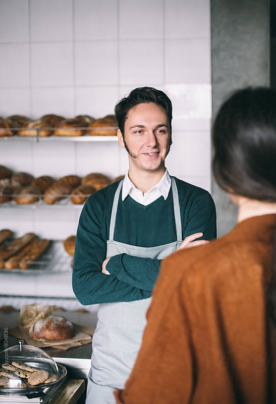 Bakery Owner Working in His Shop by Lumina for Stocksy United