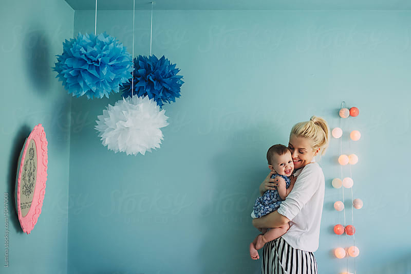 Woman and  Baby Girl Laughing at Home by Lumina for Stocksy United