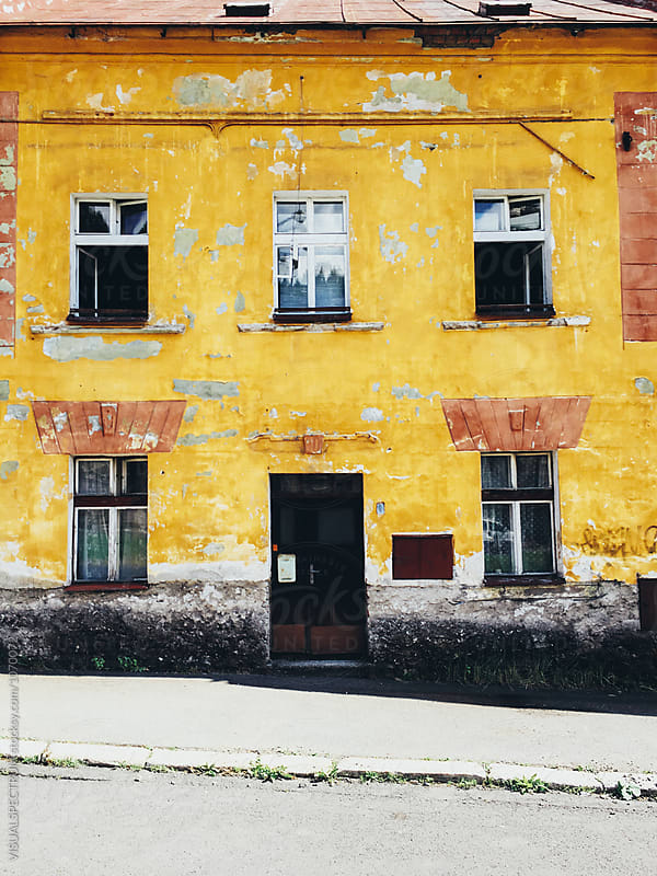 Yellow Shabby House Facade by Julien L. Balmer for Stocksy United