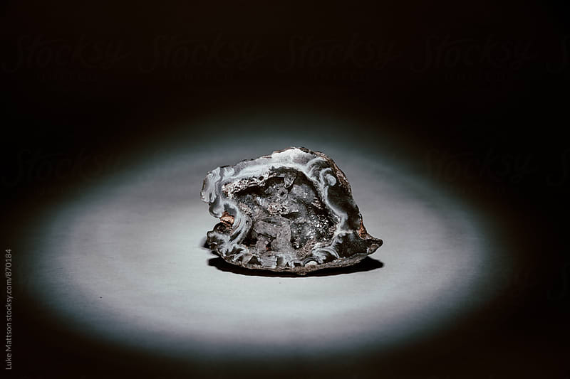 Broken Open Quartz Rock Illuminated By Spotlight by Luke Mattson for Stocksy United