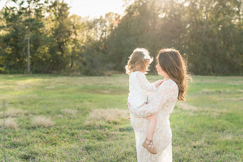 A Mother Holds Her Daughter by Alison Winterroth for Stocksy United