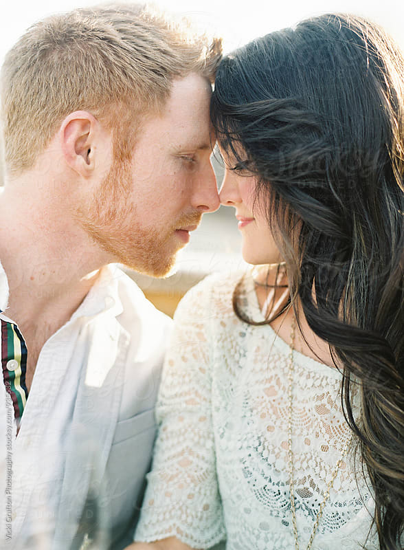 Couple in love in the sun light  by Vicki Grafton Photography for Stocksy United