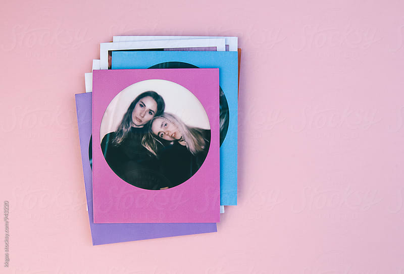 Polaroid print of best friends on a pink background. by kkgas for Stocksy United