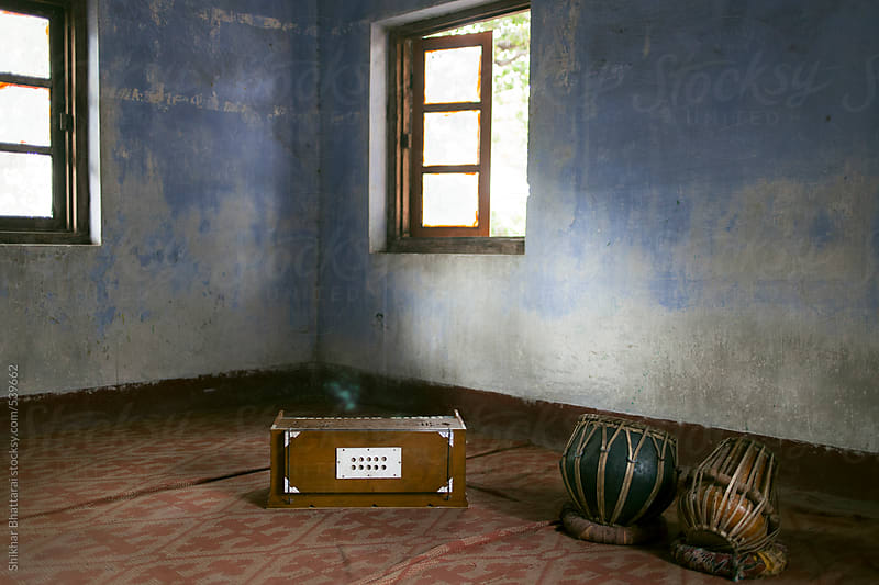 Harmonium and tabla inside a classroom. by Shikhar Bhattarai for Stocksy United