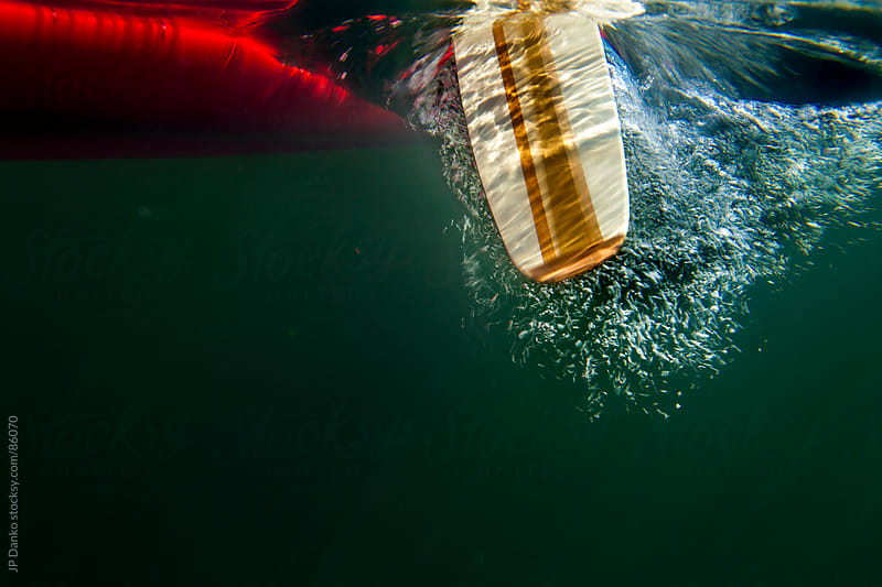 Underwater Canoe Paddle in Northern Lake while Camping by JP Danko for Stocksy United