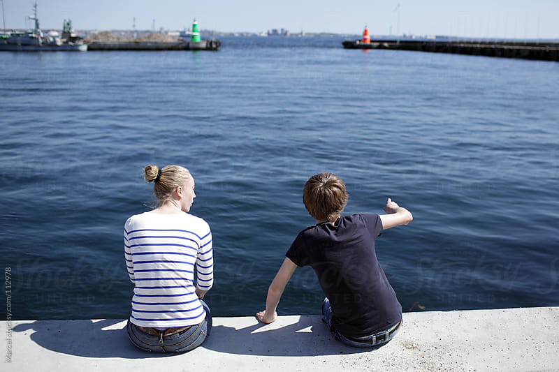 Discussing kids in the harbour by Marcel for Stocksy United