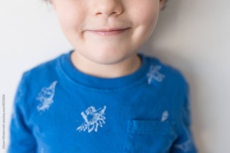 A Young Boy Smiles by Alison Winterroth for Stocksy United