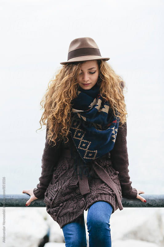 Young woman with hat and scarf, outdoors by Aleksandar Novoselski for Stocksy United