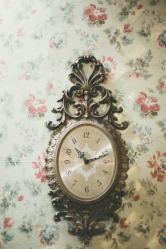 antique clock on floral wallpaper by Image Supply Co for Stocksy United