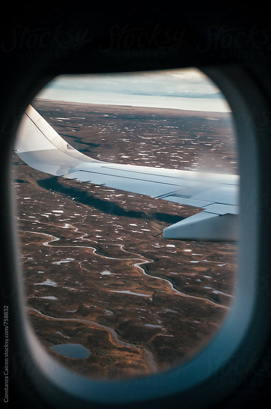 Ground view from an airplane window by Constanza Caiceo for Stocksy United
