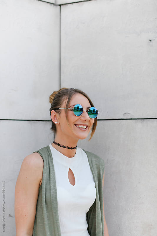 Happy woman smiling  by Marija Kovac for Stocksy United